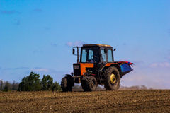 Tractor Spaying a field in the spring Stock Photography