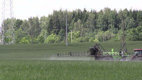 Tractor spray chemicals for crop plant protect from weed pest stock video