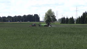 Tractor spray chemicals for crop plant protect from weed pest stock footage