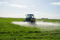Tractor spray fertilize field pesticide chemical Stock Images