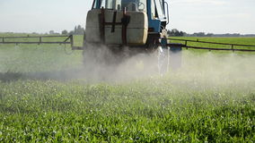 Tractor spray herbicide stock footage