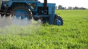 Tractor spray herbicide stock footage