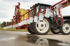 Tractor spray nozzle adjustment Royalty Free Stock Photos