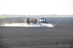 The tractor sprayed herbicides on the field. Chemistry in agricu. Lture stock images