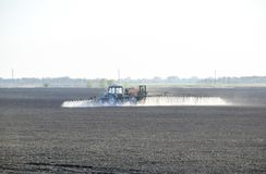 The tractor sprayed herbicides on the field. Chemistry in agricu. Lture royalty free stock photography