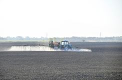 The tractor sprayed herbicides on the field. Chemistry in agricu. Lture royalty free stock photo