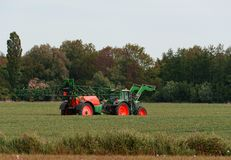 Tractor with sprayer during application of pesticides royalty free stock photo
