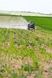 Tractor spraying, agriculture Stock Photo