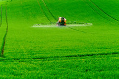 Tractor spraying the chemicals Stock Photo