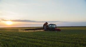 Tractor spraying crops stock photos