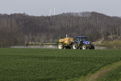 Tractor spraying field Royalty Free Stock Images