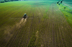 The tractor spraying the field with chemicals in the spring Stock Image