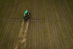 The tractor spraying the field with chemicals in the spring Stock Photography