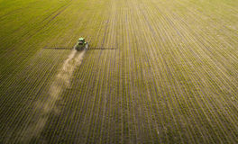 The tractor spraying the field with chemicals in the spring Royalty Free Stock Images