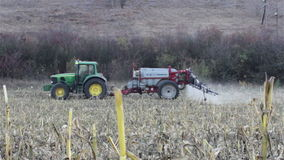 Tractor spraying field stock video footage