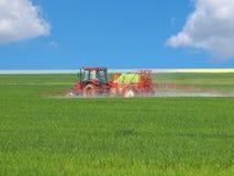Tractor spraying field Stock Photos