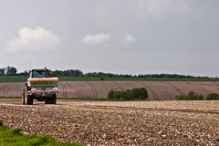 Tractor spraying a field Royalty Free Stock Photography