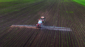 Tractor spraying field at spring Royalty Free Stock Photo