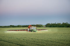 Tractor spraying on the field Royalty Free Stock Images