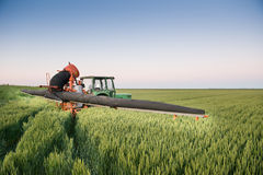 Tractor spraying on the field Royalty Free Stock Photos