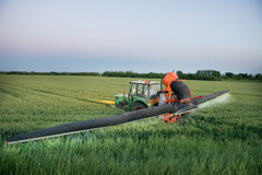 Tractor spraying on the field Royalty Free Stock Photography