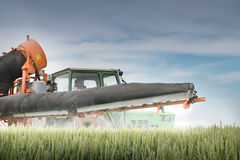 Tractor spraying on the field Royalty Free Stock Photo