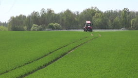 Tractor spraying fields stock footage