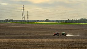 Tractor spraying pesticides, on fields in the spring Royalty Free Stock Photography