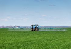 Tractor spraying pesticides Royalty Free Stock Image