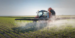 Tractor spraying pesticides Royalty Free Stock Photos