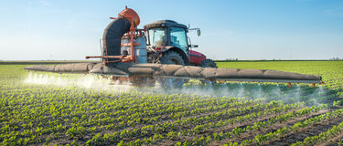 Tractor spraying pesticides Royalty Free Stock Photo