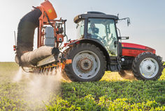 Tractor spraying pesticides. On soy bean Royalty Free Stock Photos