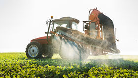 Tractor spraying pesticides Royalty Free Stock Images