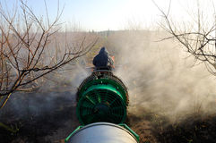 Tractor spraying plantation Royalty Free Stock Photos