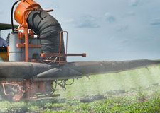 Tractor spraying soy Stock Photo
