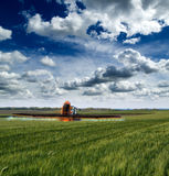 Tractor spraying soybean crops field Royalty Free Stock Photography