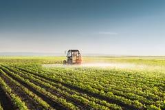 Tractor spraying soybean Stock Photos