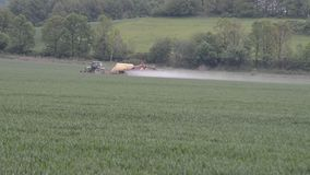 Tractor spraying soybean field stock video footage