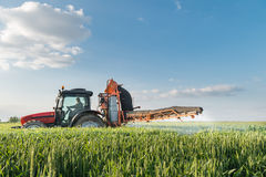 Tractor spraying wheat Royalty Free Stock Photos