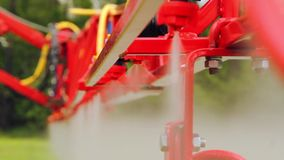 Tractor sprays a field with chemical fertilizers for agriculture stock video
