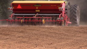 Tractor spread fertilizer and sow seeds on agriculture field. BIRZAI, LITHUANIA - AUGUST 22, 2014: Tractor spread fertilizer and sow seeds on agriculture field stock video