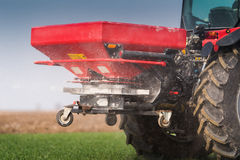Tractor spreading artificial fertilizers Royalty Free Stock Photo