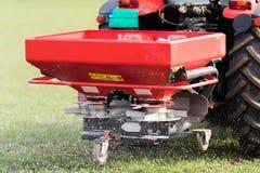 Tractor spreading artificial fertilizers Stock Photo