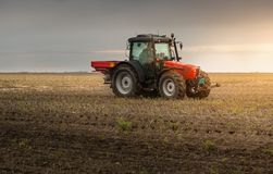 Tractor spreading artificial fertilizers Royalty Free Stock Photography