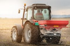 Tractor spreading artificial fertilizers Royalty Free Stock Image