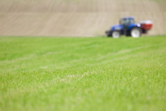 Tractor spreading fertilizer in field Stock Photo