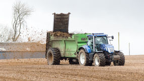 Tractor spreading fertilizer Stock Photos