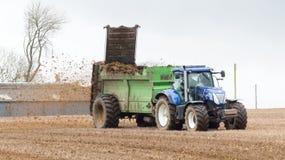 Tractor spreading fertilizer Stock Photos