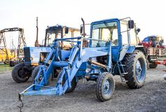 Tractor, standing in a row. Agricultural machinery. Russia, Temryuk - 15 July 2015: Tractor, standing in a row. Agricultural machinery. Parking of agricultural Stock Image