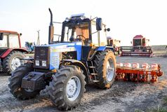 Tractor, standing in a row. Agricultural machinery. Russia, Temryuk - 15 July 2015: Tractor, standing in a row. Agricultural machinery. Parking of agricultural Royalty Free Stock Image